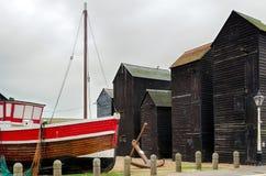 Fishing boats and huts Stock Photos