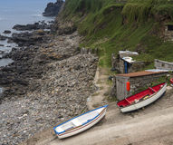 Fishing boats and huts on slipway on shore Royalty Free Stock Photo