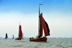 Fishing Boats on the IJsselmeer,Volendam, Holland. Fishing boats start the annual sailing regatta on the IJsselmeer, near Volendam, Holland Royalty Free Stock Photography