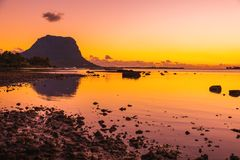 Free Fishing Boats In The Sea At Sunset Time. Le Morn Mountain In Mauritius Royalty Free Stock Image - 160468606