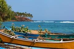 Fishing boats by the Indian Ocean. Mirissa, Sri Lanka stock photos