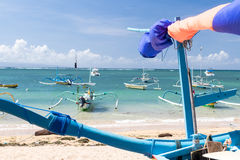 Fishing boats in the Indian ocean, tropical island Bali, Indonesia. Sanur beach. Royalty Free Stock Photography