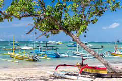 Fishing boats in the Indian ocean, tropical island Bali, Indonesia. Sanur beach. Royalty Free Stock Image