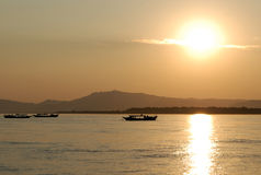 Fishing boats on the Irawaddy River at sunset Royalty Free Stock Photo