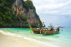 Fishing boats in Koh Phi Phi. Two traditional fishing boats on the coast of the phi phi island in thailand Royalty Free Stock Photography