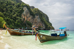 Fishing boats in Koh Phi Phi. Two traditional fishing boats on the coast of the phi phi island in thailand Stock Photography