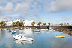 Fishing boats in the laguna `Charco de San Gines` in Arrecife. Arrecife is a Spanish port city on the island of Lanzarote Stock Photos