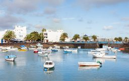 Fishing boats in the laguna `Charco de San Gines` in Arrecife. Arrecife is a Spanish port city on the island of Lanzarote Stock Photo