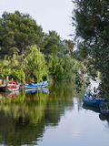 Fishing Boats on a Lake. Fishing boats tied on the shore of a lake during a summer sunny day Stock Photos