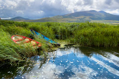 Fishing boats in a lake in County Kerry, Ireland Stock Photo