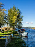 Fishing boats in a lake Stock Images