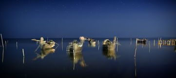 Fishing boats on the lake by night Royalty Free Stock Photo