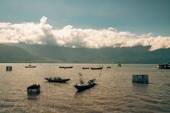 Fishing boats on a lake in vietnam. Beautiful Royalty free stock photo. fishing boats on a lake in vietnam Royalty Free Stock Photo