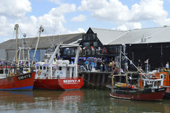 Fishing boats line the harbour during the Whitstable Oyster Festival. WHITSTABLE, UK-JULY 22:Fishing boats line the harbour during the annual Whitstable Oyster Stock Photo