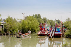 Fishing boats line up on the river Stock Photos