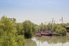 fishing boats line up on the river banks Stock Images