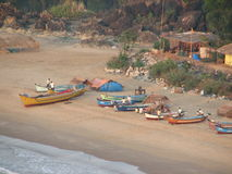 Fishing boats lined along the shore. India, Karnataka Stock Photo