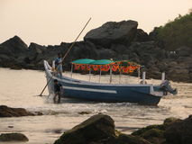 Fishing boats lined along the shore. India, Karnataka Royalty Free Stock Photos
