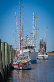 Fishing boats lined up at port Royalty Free Stock Images