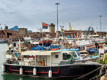 Fishing boats in Livorno harbor, Italy Stock Photo