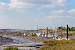 Fishing boats at low tide. Fishing boats are anchored in mud at low tide Royalty Free Stock Images