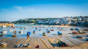 St. Ives harbor with boats at sunset in Cornwall, UK royalty free stock photography