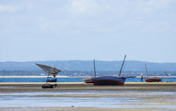 Fishing boats with low tide. In Mozambique Stock Photos