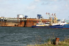 Fishing boats and dry dock. Fishing boats lying at the dry dock for repairs at the port of Lauwersoog Stock Photos