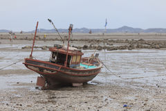 Fishing  boats lying on the sea floor at low tide. Stock Photo