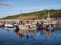 Fishing Boats at Lyme Regis Harbour Stock Photos