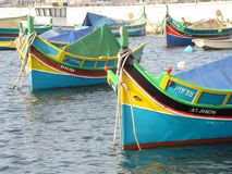 Fishing Boats in Malta. Approach to Lisbon at sunrise Royalty Free Stock Photography