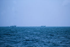 Fishing boats march.... Stock Image
