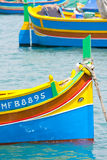 Fishing boats in Marsaxlokk. Close up of colourfully painted traditional fishing boat in Marsaxlokk Malta Stock Image