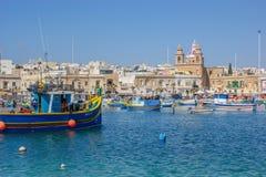 Fishing boats at Marsaxlokk Fishing Village. Picturesque fishing boats in the Maltese fishing village of Marsaxlokk Royalty Free Stock Photo