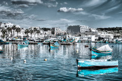 Fishing boats in Marsaxlokk, fishing village in the South Easter. Malta - 14 Jan 2016: Fishing boats in Marsaxlokk, fishing village in the South Eastern Region Royalty Free Stock Images
