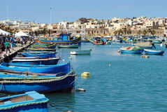 Fishing boats in Marsaxlokk. Traditional fishing boats in Marsaxlokk, a fishing village located in the south-eastern part of Malta, with a population of 3,277 Stock Photography