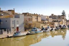 Fishing boats, Mazara del Vallo, Italy. Fishing boats on a canal in Mazara del Vallo, a town in Sicily in southern Italy Royalty Free Stock Photography