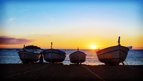 Fishing boats in the Mediterranean Sea on sunrise background.  stock photography
