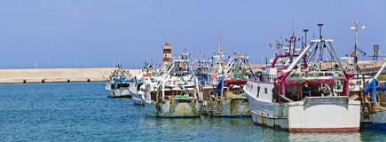 Fishing boats at Monopoli. Some fishing boats before the mole at the port of Monopoli, Italy Stock Image