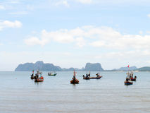 Fishing boats moored along the beach. Background Stock Photos