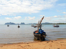 Fishing boats moored along the beach. Background Royalty Free Stock Photo