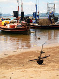 Fishing boats moored along the beach. Background Royalty Free Stock Photography