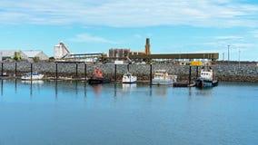 Fishing Boats Moored At Harbor royalty free stock photos