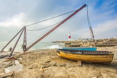 Fishing boats moored on beach Stock Image