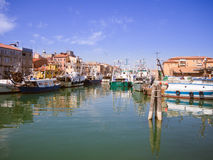 Fishing boats moored in a canal in Chioggia, Italy. Royalty Free Stock Photography