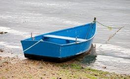 Fishing boats moored on the coast Stock Photos