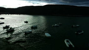 Fishing boats moored in the cozy little bay on the Croatian shore stock video footage