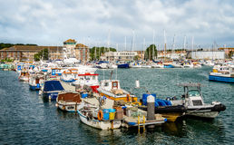 Fishing Boats Moored in the Harbour. A variety of fishing boats, moored on a pontoon, in the Marina, Weymouth Harbour in the South of England Stock Photography