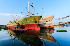 Fishing boats moored. Large fishing boats moored along the Tha Chin River in Thailand Stock Photos