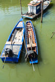 Fishing boats moored in the mangroves. Stock Photography